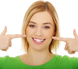woman pointing at healthy smile