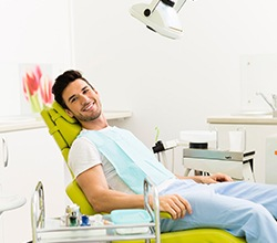 Smiling man in dental exam chair