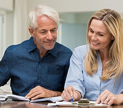 Smiling older couple reviewing finances