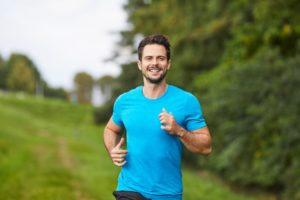 Man jogging in a blue shirt